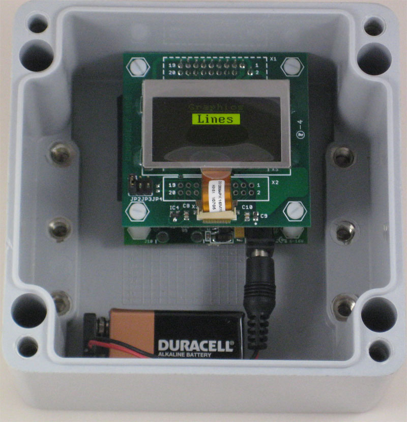OLED-1 Board and battery inside enclosure with running OLED Demo firmware
